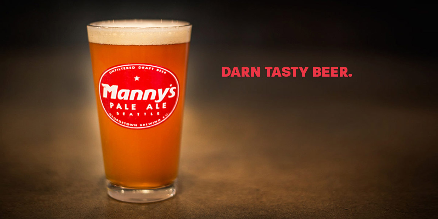 Glass of Mannys Pale Ale with text Darn Tasty Beer