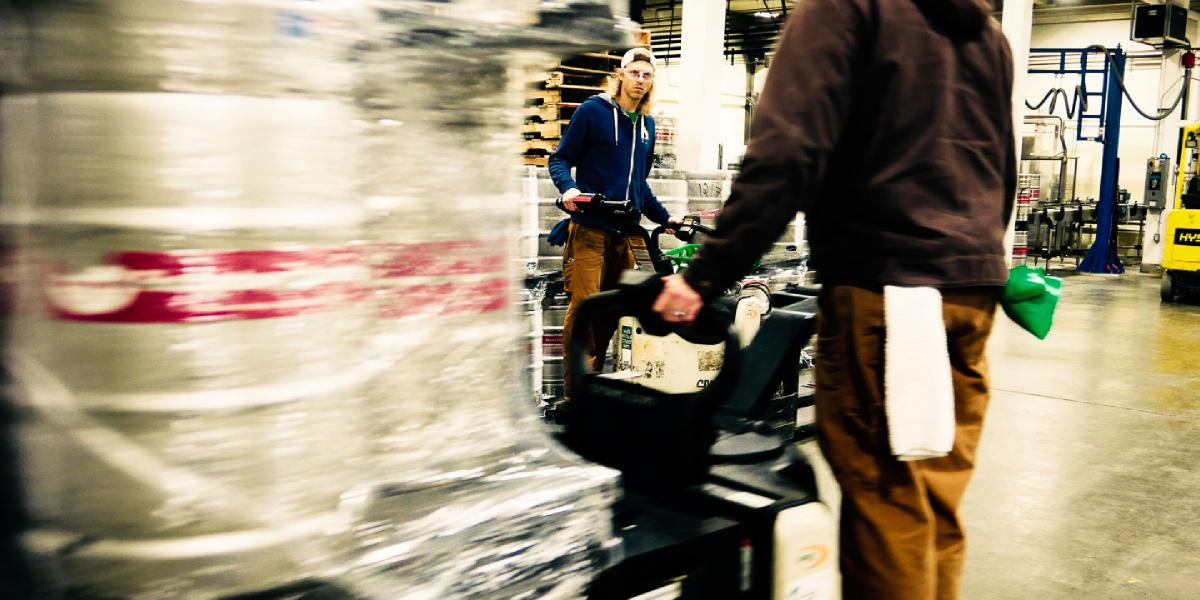 Brewer Craig transports kegs on an electric pallet jack